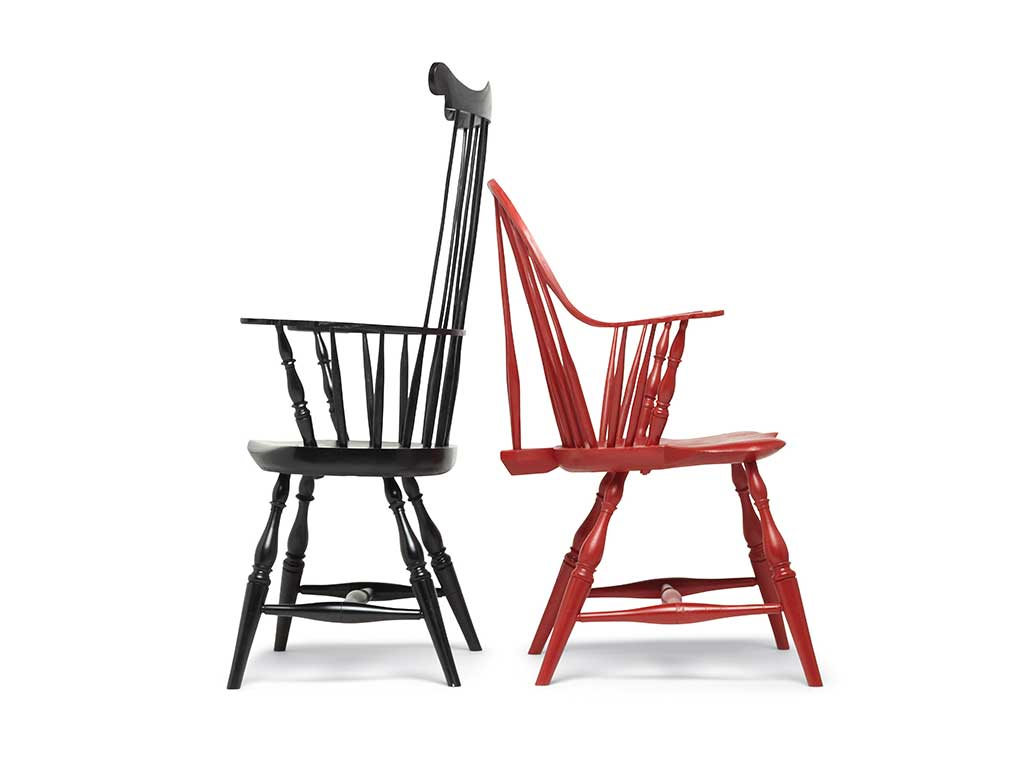 black comb-back and red sack-back Windsor chairs