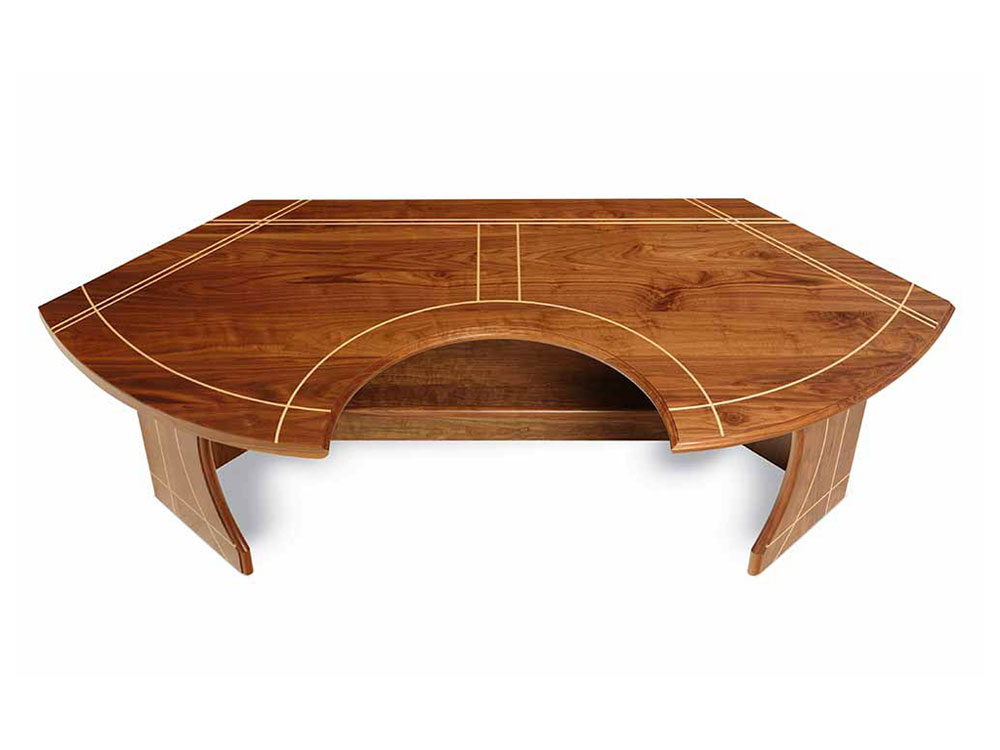 curved walnut desk with maple inlay