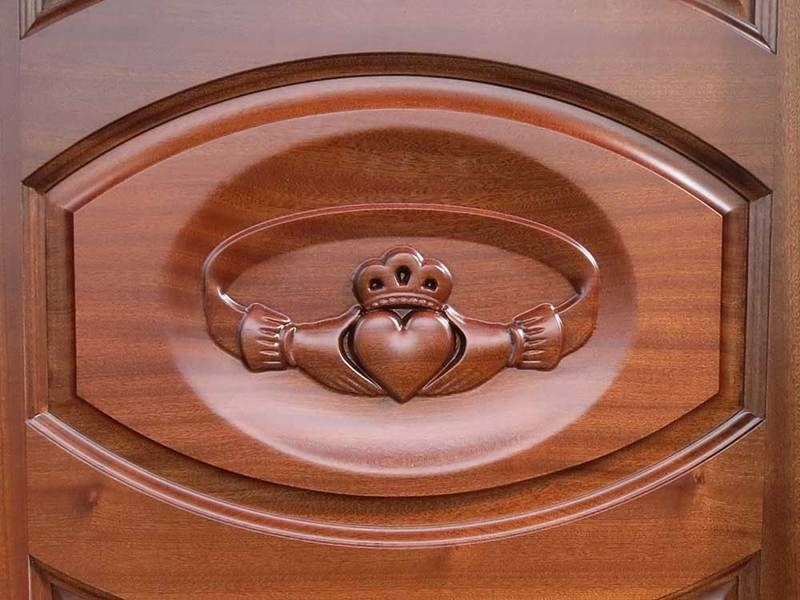 claddagh ring carved in mahogany door