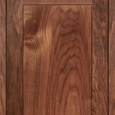 walnut kitchen cabinet door with scalloped patterned front