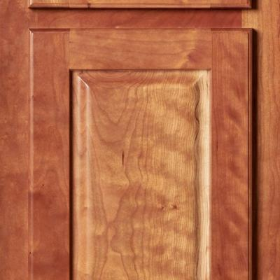 figured cherry kitchen cabinet door with overlay