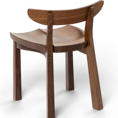 standard serpentine chair in fumed oak rear view