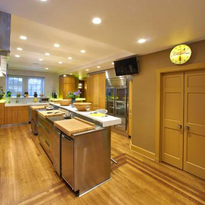 Custom bamboo kitchen with block cutting boards over stainless countertops