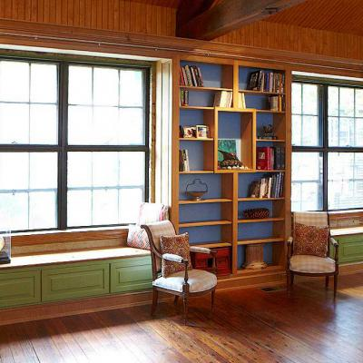 carriage house in white oak and lacquered maple with built-in maple library and window seats